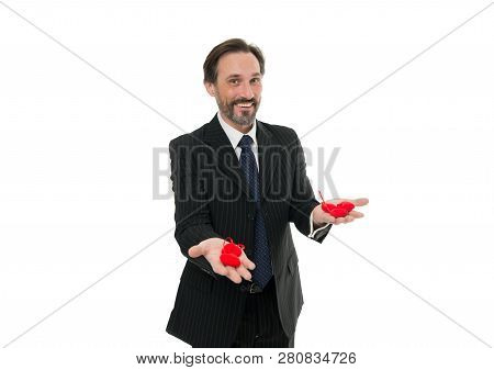 Take my heart. heart attack. businessman with beard in formal suit. Love and romance health care. February holiday. mature man hold valentines heart. Happy man with big red heart. Hard choice to make. stock photo