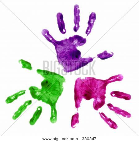 three multi colored finger painted hands stock photo