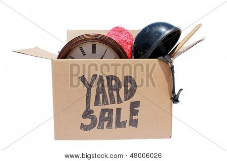 A Genuine Box of used items ready for a garage sale, Yard Sale, Auction, or donation to a charitable organization. One man's junk is another man's treasure! Isolated on white with room for your text  stock photo