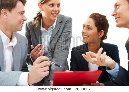 Photo of business partners discussing plan or new project at meeting stock photo