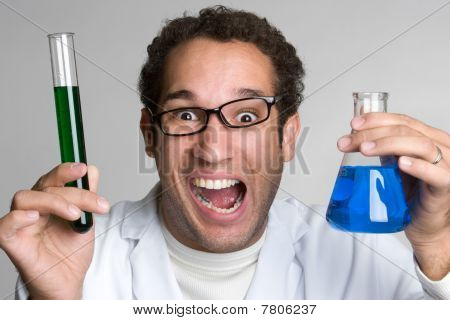 Mad scientist holding chemicals in test tube stock photo