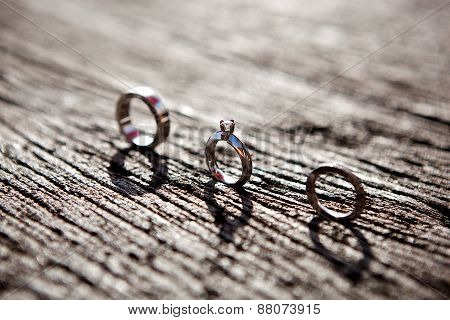 wedding engagement anniversary eternity bands rings on wood surface stock photo