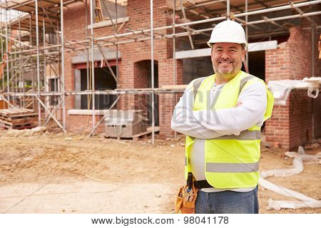 Portrait Of Construction Worker On Building Site