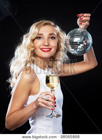 beautiful blond woman in evening dress with wine and disco ball stock photo