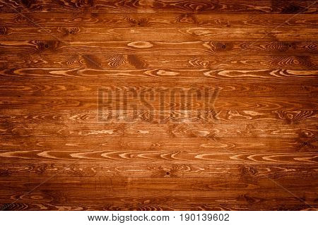 Empty wood table for product placement or montage. Wood table top view. Wood table surface. Rustic wood table background. Large dinner empty wood table top. Wood table texture background. Plank board of wood table. Wood table worktop. stock photo