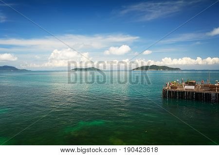 Traveler have fun on the jetty of the port in the sunny day Rawa island Malaysia . stock photo