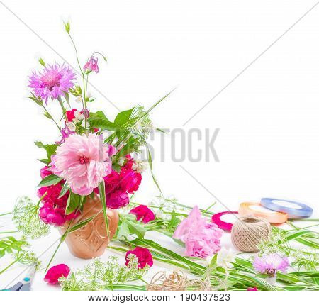 floral design. beautiful bouquet of pink flowers peons cornflowers and red roses on white background with space for text stock photo