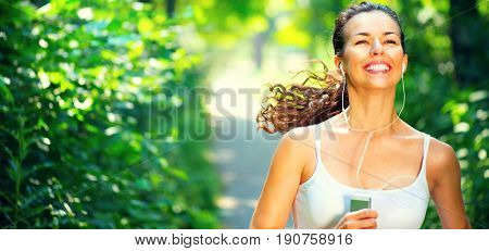 Running sporty woman. Female Runner Jogging during Outdoor Workout in a morning Park. Beautiful fit