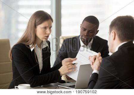 Angry dissatisfied businesswoman holding contract arguing with contractor, pointing at terms failed to perform, demanding termination, loss compensation, defrauded cheated investor protecting rights stock photo