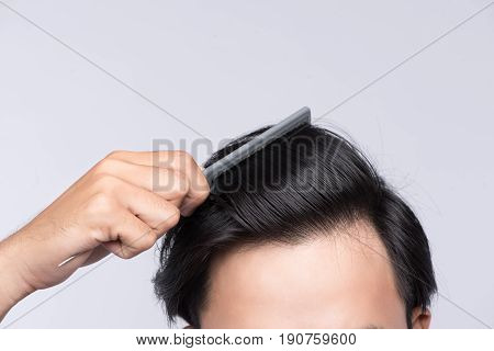 Close up photo of clean healthy man's hair. Young man comb his hair stock photo