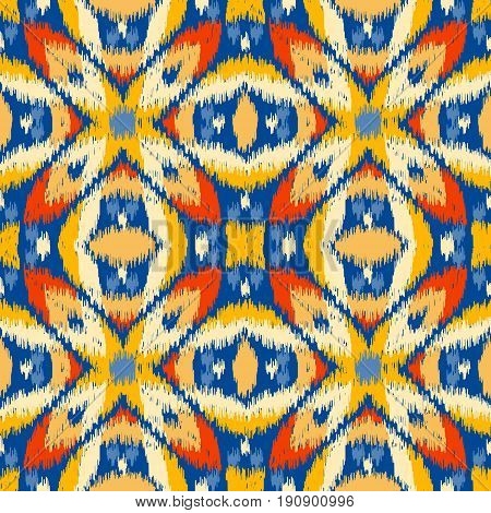 Seamless geometric pattern based on ikat fabric style. Vector illustration. Carpet rug texture vector imitation. Colorful rug pattern in yellow red blue and orange. stock photo