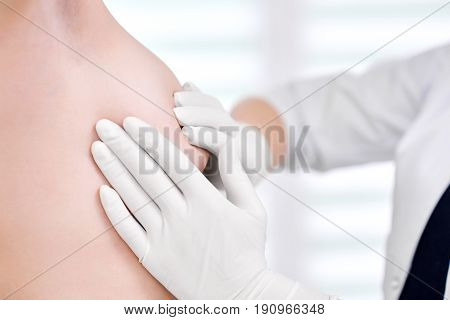 Cropped shot of a professional doctor examining breast of her female patient mammography mammalogy breast cancer awareness health medicine clinical concept. stock photo