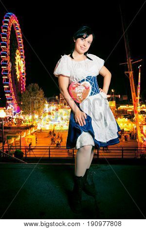 a young woman at the cannstatter wasen in stuttgart, an event very similar to the better-known 'oktoberfest' in munich. stock photo