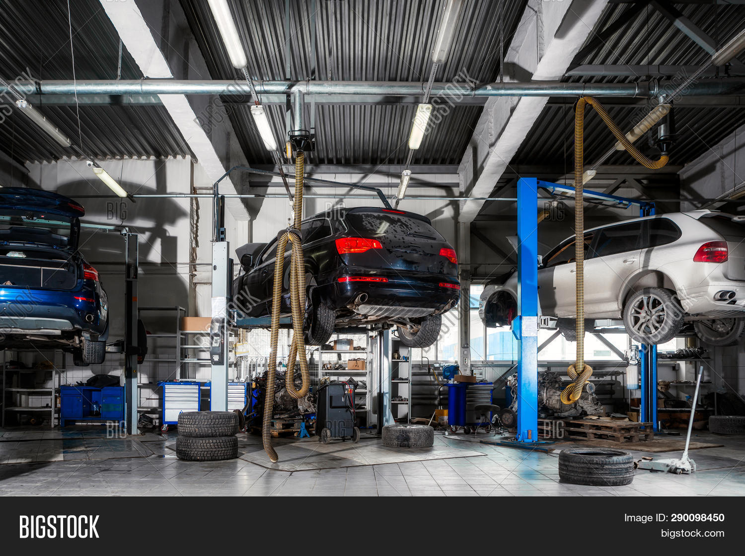 Car Repair On A Lift For The Repair Of The Chassis, Automatic Transmission And Engine In The Auto Re