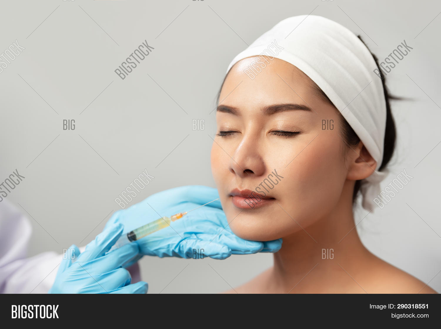 Cheek filler injection treatment injection. Woman face plastic surgery. Beauty and cosmetic concept. Skincare and anti aging theme.