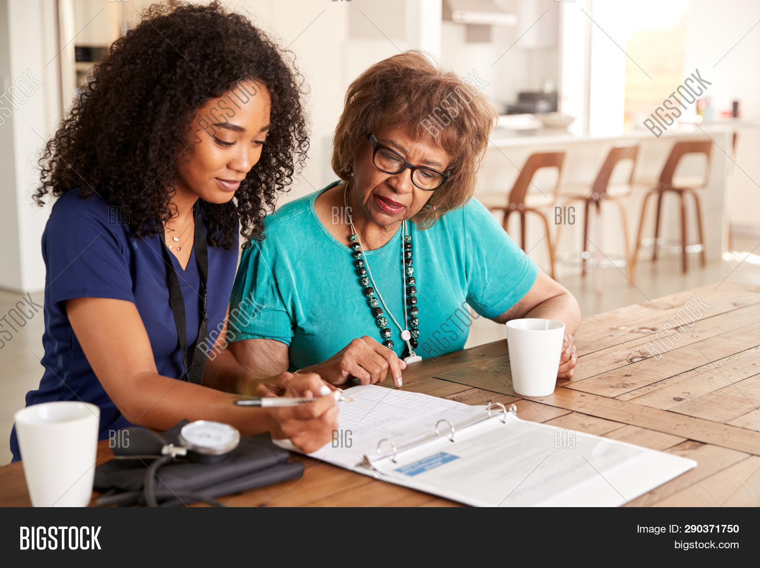 20s,80s,adults,african american ethnicity,age,black,care,casual clothing,close up,concentrating,convenience,copy space,cups,curly hair,day,dining room,diversity,doctor,domestic life,filling in form,health care,health check,home,home visit,horizontal,indoors,making notes,medical check up,medical records,millennial,mixed race person,nurse,retirement,senior,serious,sitting at table,sunlight,tea cups,two people,waist up,wearing glasses,women,young adult