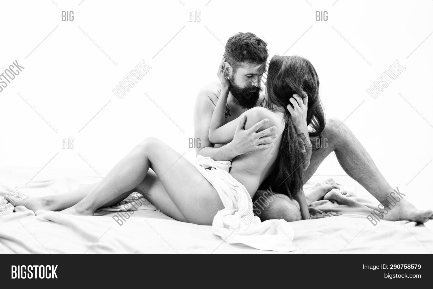 Couple Lovers Naked Hug Or Cuddling In Bed. Art Of Seduction. Hipster Seduce Attractive Girl. Desire