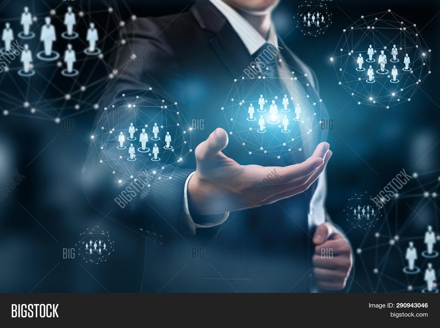 A Closeup Of A Businessman Holding A System Of Digital Spheres With Human Figure Models Inside. The