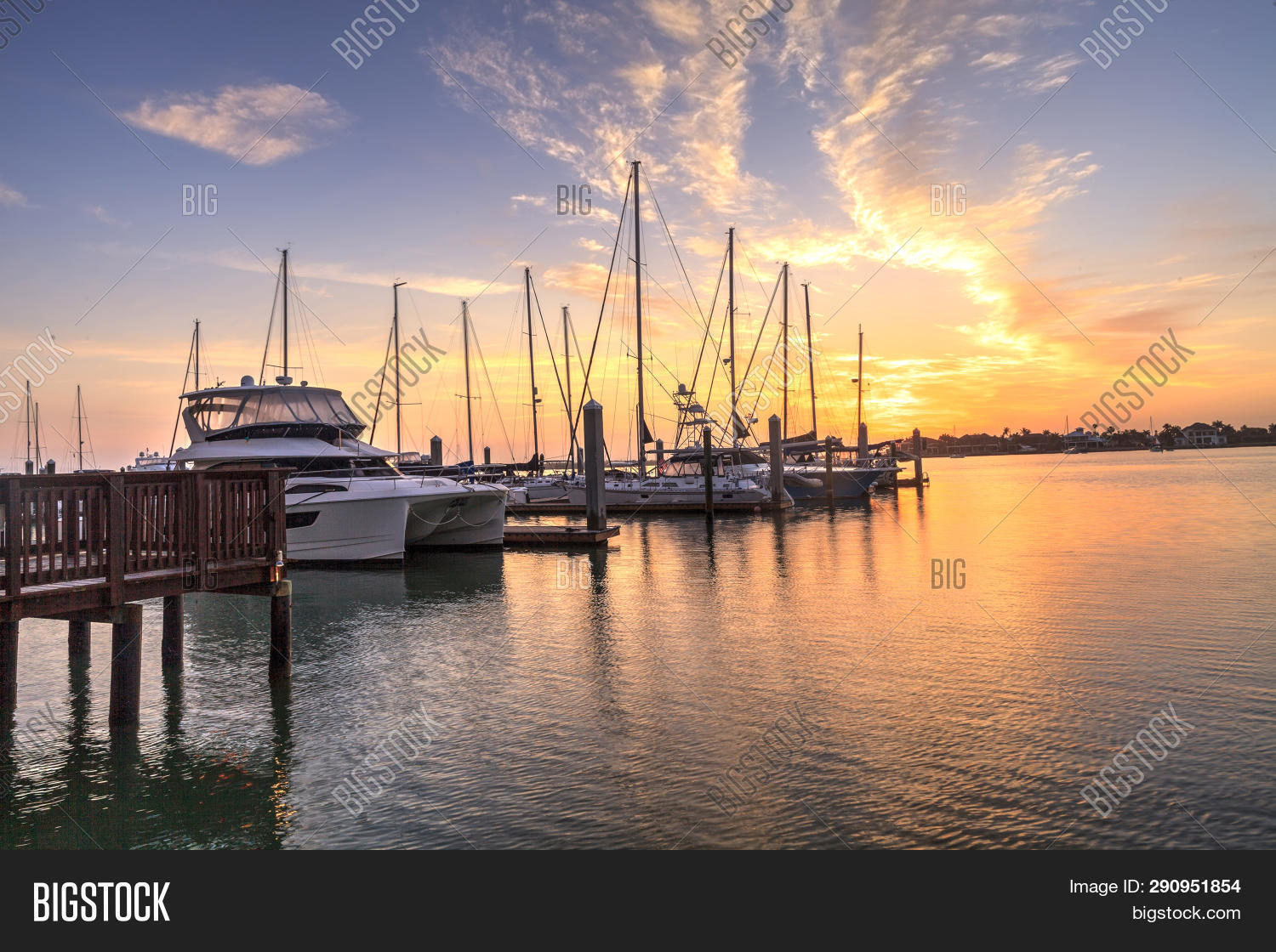Break Of Dawn Sunrise Over Boats And Sailboats At Factory Bay Marina In Marco Island