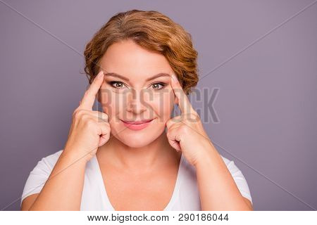 Close up photo beautiful amazing model she her lady hold hands arms eyelid check wrinkles great wow omg result look mirror satisfied becoming younger wear white t-shirt isolated grey background stock photo