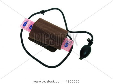 Blood pressure cuff for home monitoring for health maintenance around a daily pill container-Path included stock photo