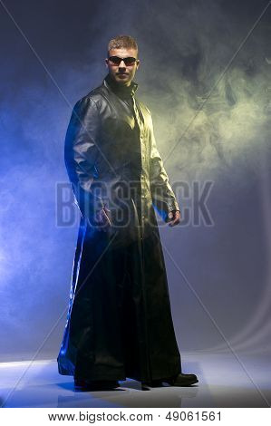 Matrix Style Role Play Character Adult Man in Trench Coat stock photo