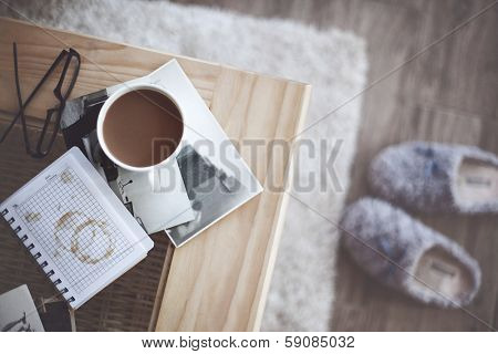 Still life details, cup of coffee and retro vintage black-and-white photos, top view point