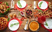 High point perspective of table served for thanksgiving supper with family