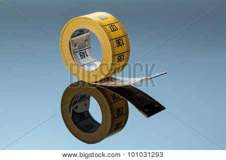 yellow tape measure, symbolfoto for diet control and precision stock photo