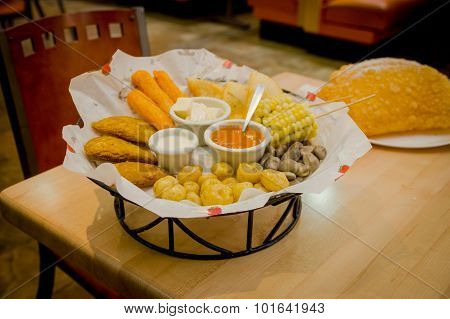 Mixed platter beautifully arranged with mix of typical latin foods such as empanadas, corn, abbas and salsas. stock photo