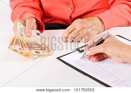 Senior woman paying for her medical bills stock photo