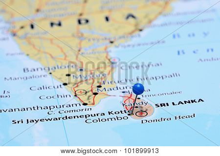 Photo of pinned Sri Jayewardenepura Kotte on a map of Asia. May be used as illustration for traveling theme. stock photo