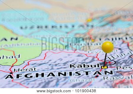 Photo of pinned Kabul on a map of Asia. May be used as illustration for traveling theme. stock photo
