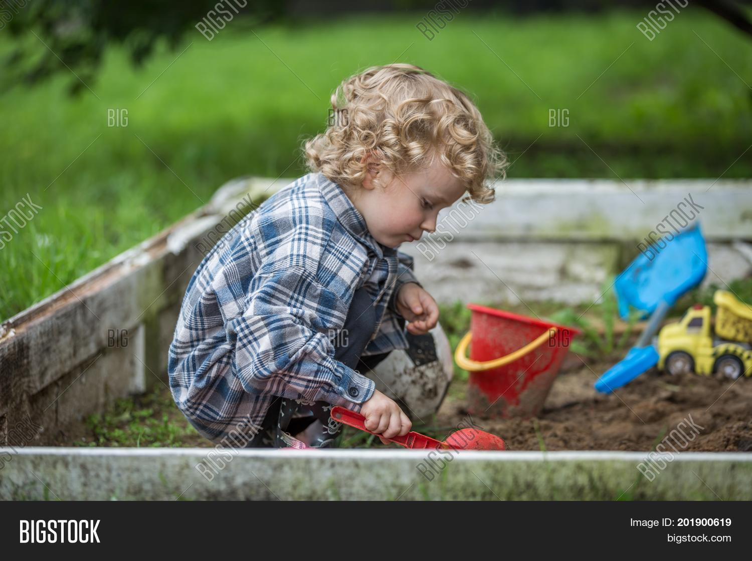 active,adorable,alone,baby,ball,beautiful,blond,boy,bright,bucket,casual,caucasian,child,childhood,color,concentrated,curly,cute,digging,dirty,enjoying,hair,happy,healthy,kid,kindergarten,little,looking,lost,natural,nature,one,outdoors,person,playful,playground,portrait,safety,sand,sandbox,sandpit,shirt,summer,sunny,thought,toddler,toy,young
