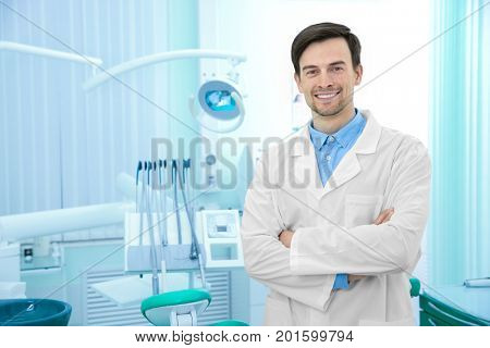 Young male dentist in light office stock photo