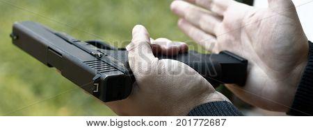 Loading Handgun. Reloading handgun. Man  Reloading handgun. stock photo