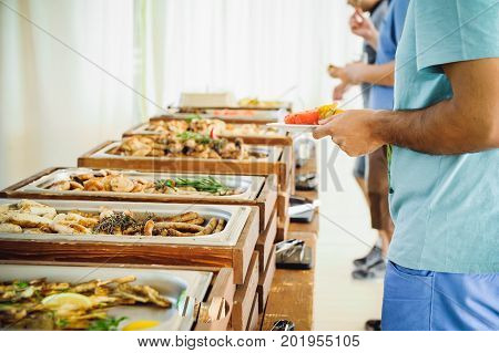 Outdoor Cuisine Culinary Buffet Dinner Catering. Group of people in all you can eat. Dining Food Celebration Party Concept. Service at business meeting weddings. Selective focus stock photo