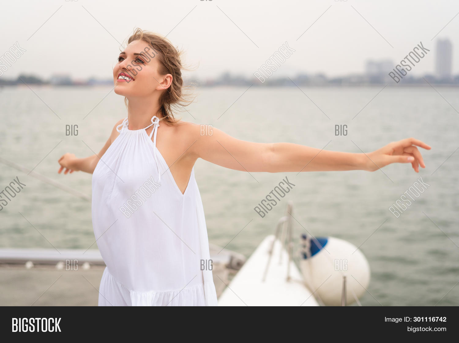 arms,attractive,background,beautiful,beauty,blue,boat,carefree,casual,caucasian,cheerful,cruise,enjoying,female,free,freedom,fun,girl,happiness,happy,healthy,holiday,joy,lifestyle,looking,model,nature,nautical,ocean,open,outdoors,people,relax,sailboat,sailing,sea,ship,sky,smile,success,summer,sunny,travel,vacation,voyage,water,white,woman,yacht,young
