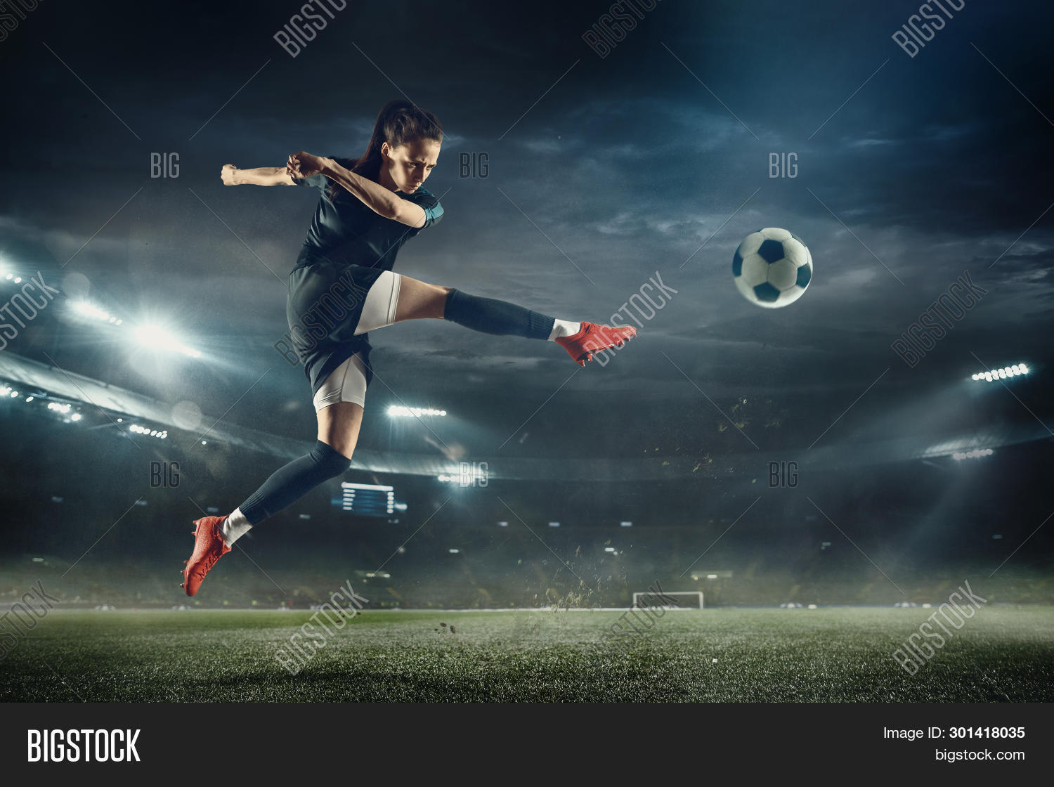 action,active,adolescence,adult,athlete,background,ball,beautiful,beauty,boots,bouncing,caucasian,championship,cheerful,clothing,competition,competitive,control,enjoyment,equipment,expression,female,football,grass,happiness,holding,indoors,isolated,jersey,jumping,kicking,one,person,player,playing,portrait,posing,professional,shoes,shorts,sky,soccer,sport,sportwear,stadium,team,tricks,woman,world,young