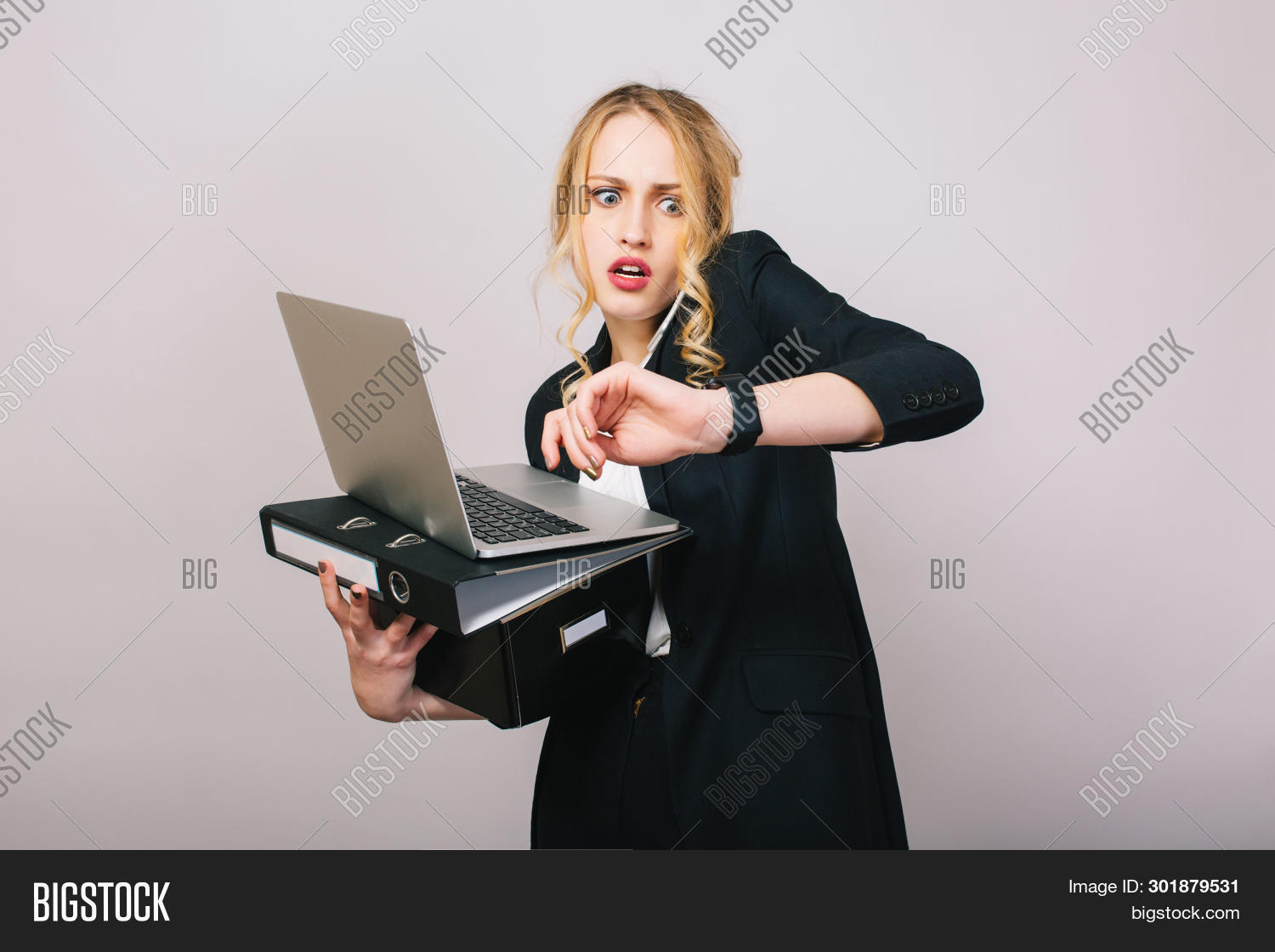 adult,agent,astonished,attractive,background,beautiful,box,business,businessperson,businesswoman,busy,career,confident,corporate,documents,elegant,employment,executive,face,female,folder,formal,internet,isolate,isolated,job,lady,laptop,late,manager,modern,office,phone,portrait,pretty,problem,profession,secretary,standing,studio,successful,suit,talk,time,watch,white,woman,work,worker,young