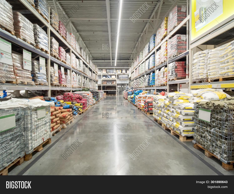 Warehouse Industrial Premises For Storing Material. Warehouse Of Building Materials In Industiral St