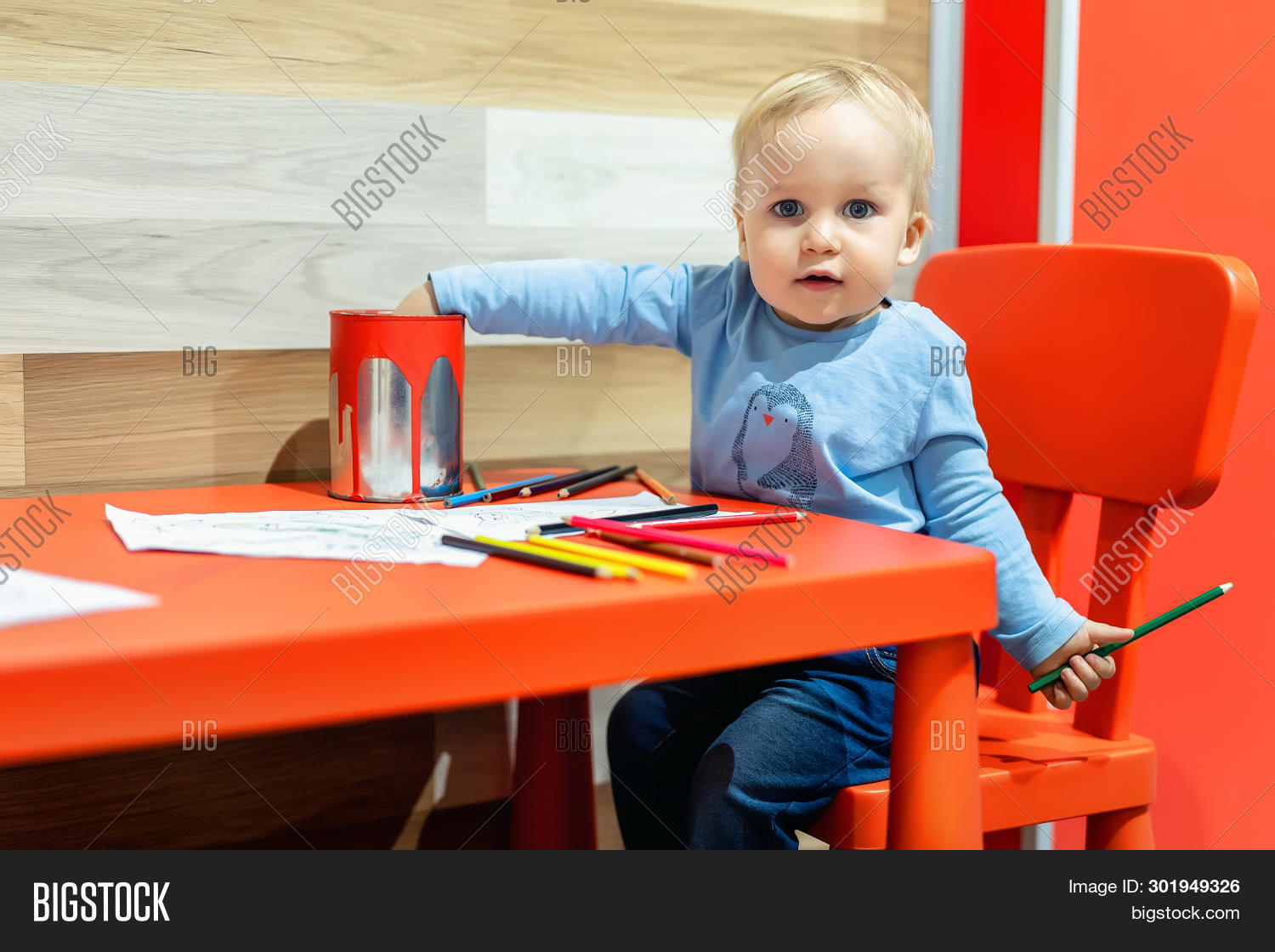 Cute Little Caucasian Blond Toddler Boy Sitting At Table And Drawing At Children Area At Retail Clot