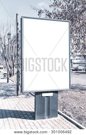 Vertical small billboard in the city on the sidewalk. Mock up for your advertising or announcements stock photo