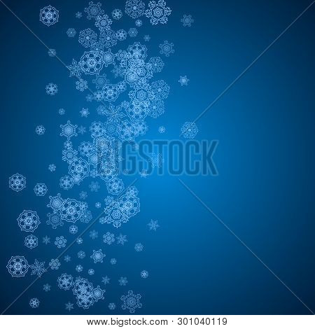 New Year snowflakes on blue background with sparkles. Winter theme. Christmas and New Year snowflakes  falling. For season sales, special offer, banners, cards, party invites, flyer. White frosty snow stock photo