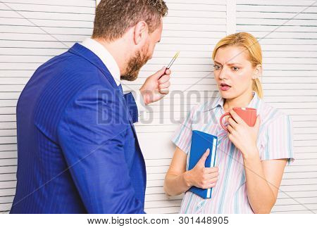 Prejudice and personal attitude to employee. Tense conversation or quarrel between colleagues. Boss discriminate female worker. Discrimination and personal attitude problem. Discrimination concept stock photo