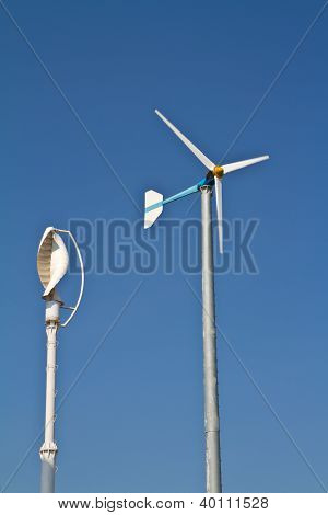 Vertical axis and normal wind turbine on blue sky stock photo