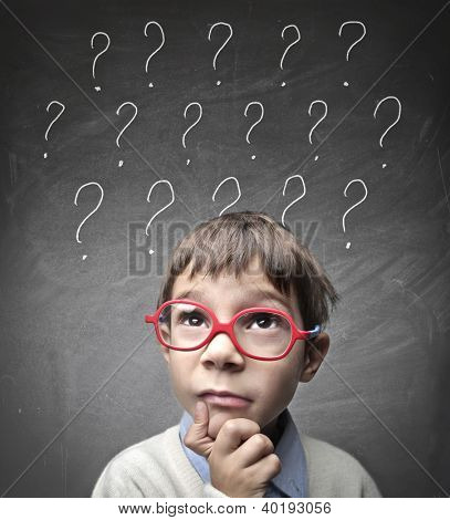 Child with numerous question marks