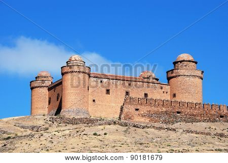 View of the castle (Castillo de La Calahorra) with the snow capped mountains of the Sierra Nevada to the rear La Calahorra Granada Province Costa Almeria Andalusia Spain Western Europe. stock photo