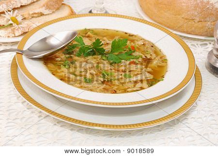 traditional Polish Tripe Soup (flaki)with vegetables in white plate stock photo