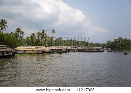 Backwaters in Kerala India. The backwaters are an extensive network of 41 west flowing interlocking rivers lakes and canals that center around Alleppey Kumarakom and Punnamada. stock photo